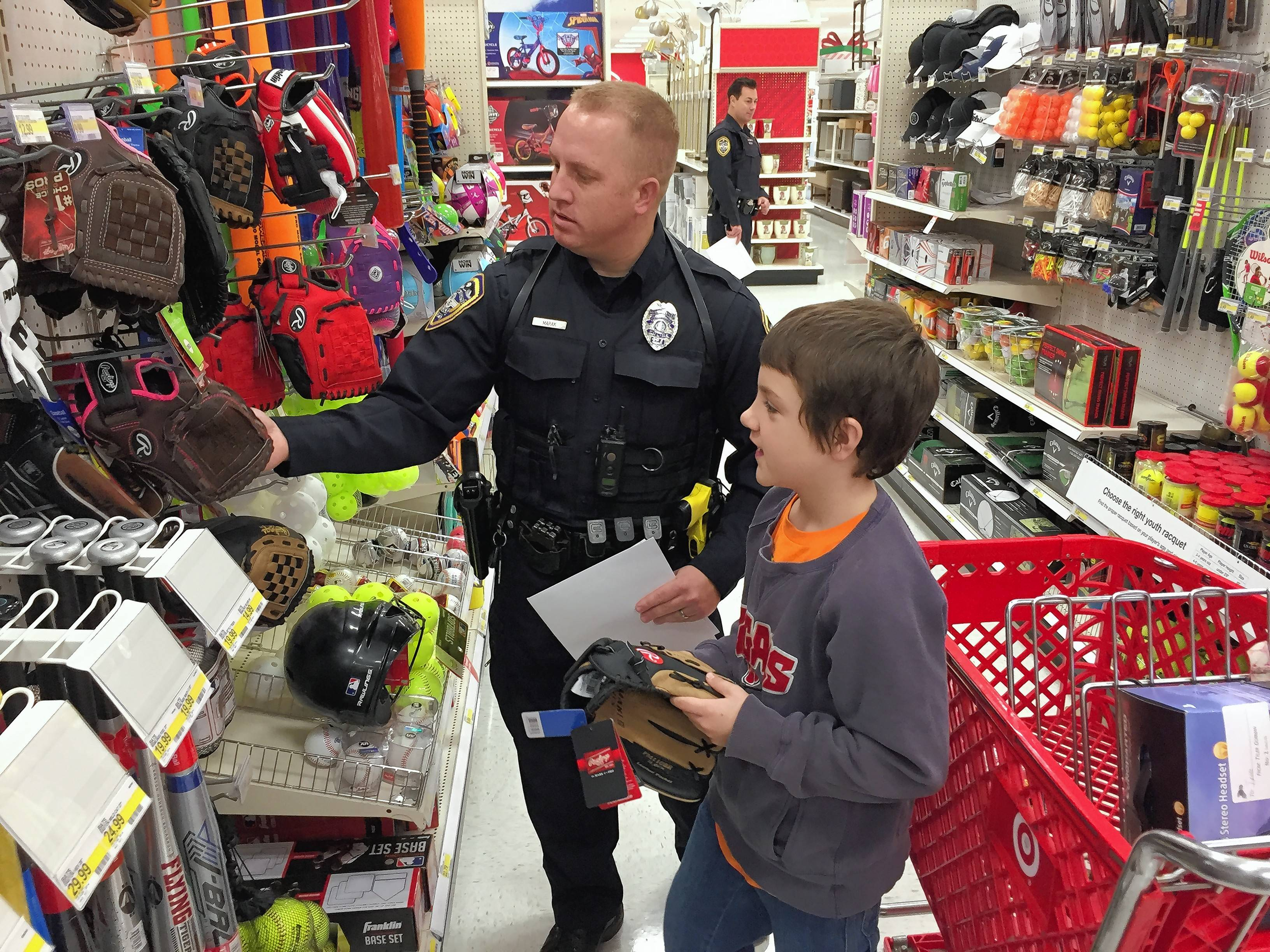 "It took Hoffman Estates police officer Adam Marak and his shopping partner time to get everything the youngster wanted during Saturday's Shop with a Cop event in Hoffman Estates. ""We spent 30 minutes just circling the building,"" Marak later joked."