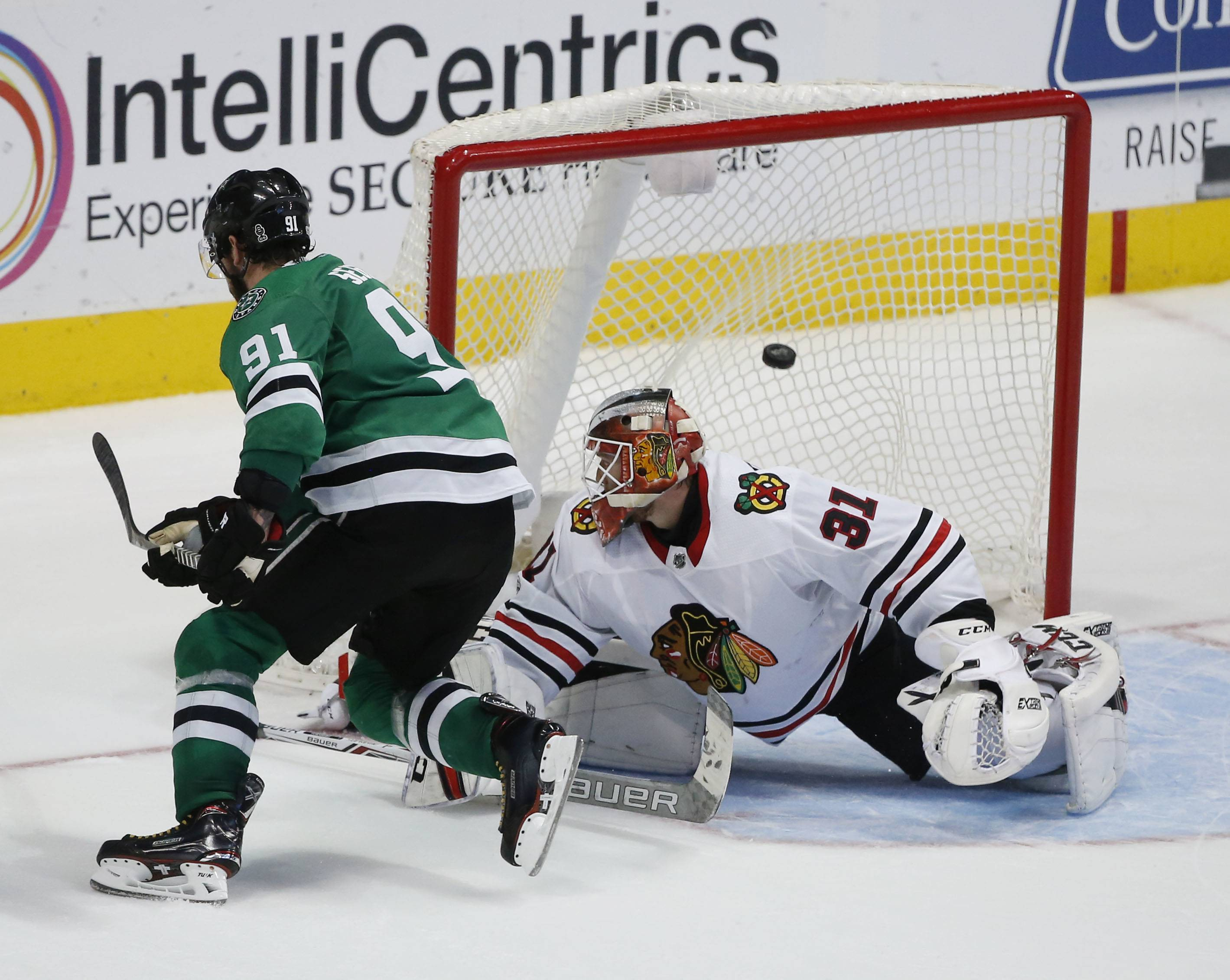 Dallas Stars center Tyler Seguin (91) gets the puck past Chicago Blackhawks goalie Anton Forsberg (31) during the shootout of an NHL hockey game, Saturday, Dec. 2, 2017, in Dallas. The Stars defeated the Blackhawks 3-2. (AP Photo/ Michael Ainsworth)