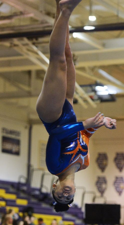 Buffalo Grove's Madison Morelli competes on the floor exercise during the Rolling Meadows invite Saturday.
