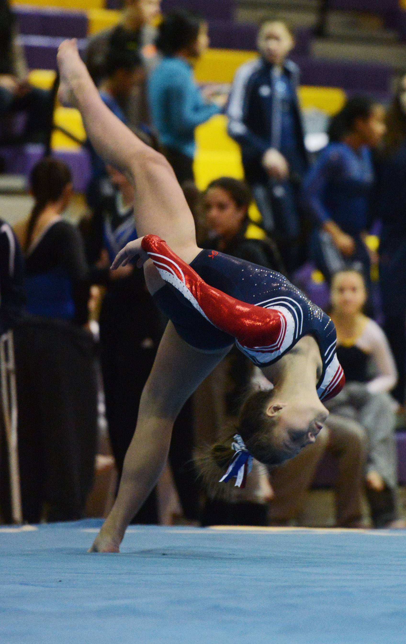 Conant's Sarah Taucher competes on the floor exercise during the Rolling Meadows invite Saturday.