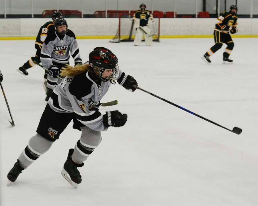"Drew Ternovits, a defenseman on the D211 Chiefs hockey team, competes in a recent game against Stevenson High School. ""As soon as I tried (hockey), I loved it,"" Drew said. ""I love the speed. I love how everything moves at once."""