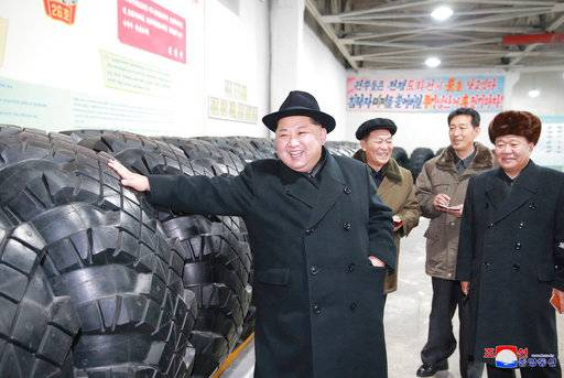 "In this undated photo provided on Sunday, Dec. 3, 2017, by the North Korean government, North Korean leader Kim Jong Un inspects a local tire factory in Chagang Province, North Korea. Kim thanked workers at a factory that built the tires for a huge vehicle used to transport a new intercontinental ballistic missile that was test-launched this week. Independent journalists were not given access to cover the event depicted in this image distributed by the North Korean government. The content of this image is as provided and cannot be independently verified. Korean language watermark on image as provided by source reads: ""KCNA"" which is the abbreviation for Korean Central News Agency. (Korean Central News Agency/Korea News Service via AP)"