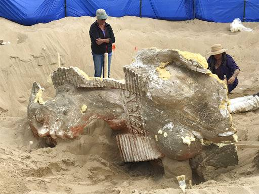 "In this Nov. 3, 2017 photo provided by the Guadalupe-Nipomo Dunes Center, is the front of an uncovered sphinx featuring ornate detail, including a detailed necklace in Guadalupe, Calif. Archaeologists working in sand dunes on the central California coast have dug up an intact plaster sphinx that was part of an Egyptian movie set built more than 90 years ago for filming of Cecil B. DeMille's 1923 epic ""The Ten Commandments."" (Guadalupe-Nipomo Dunes Center via AP)"