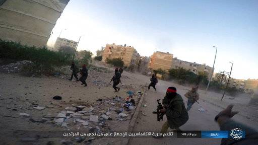 FILE - This photo posted on a file sharing website Wednesday, Jan. 11, 2017, by the Islamic State Group in Sinai, a militant organization, shows a deadly attack by militants on an Egyptian police checkpoint, in el-Arish, north Sinai, Egypt. The Egypt mosque massacre could point to the rise of an ultra-extremist faction that is so radical in its readiness to kill fellow Muslims that it has caused rifts within the Islamic State group _ already notorious for its atrocities. (Islamic State Group in Sinai via AP, File )