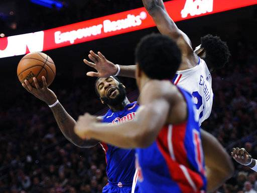 CORRECTS TO SATURDAY NOT FRIDAY - Detroit Pistons' Andre Drummond (0) is blocked by Philadelphia 76ers' Joel Embiid (21) during the first half of an NBA basketball game, Saturday, Dec. 2, 2017, in Philadelphia. (AP Photo/Michael Perez)