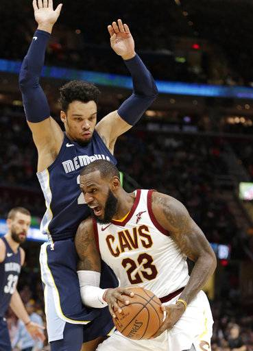 Cleveland Cavaliers' LeBron James (23) drives against Memphis Grizzlies' Dillon Brooks (24) in the first half of an NBA basketball game, Saturday, Dec. 2, 2017, in Cleveland. (AP Photo/Tony Dejak)