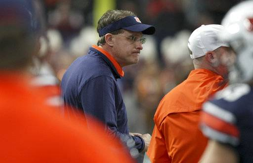 Auburn coach Gus Malzahn watches his team warm up for the Southeastern Conference championship NCAA college football game against Georgia on Saturday, Dec. 2, 2017, in Atlanta, Ga. (C.B. Schmelter/Chattanooga Times Free Press via AP)