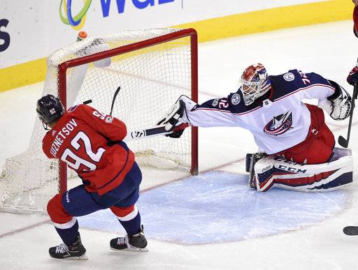 Washington Capitals center Evgeny Kuznetsov (92), of Russia, scores a goal against Columbus Blue Jackets goalie Sergei Bobrovsky (72), also of Russia, during the third period of an NHL hockey game, Saturday, Dec. 2, 2017, in Washington. (AP Photo/Nick Wass)