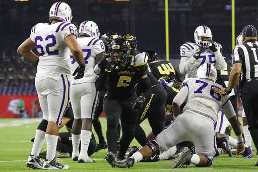 Grambling State linebacker De'Arius Christmas (5) reacts after a fourth-down stop in the third quarter during the Southwestern Athletic Conference championship football game against Alcorn State in Houston, Texas, Saturday, Dec. 2, 2017. (Tim Warner/Houston Chronicle via AP)
