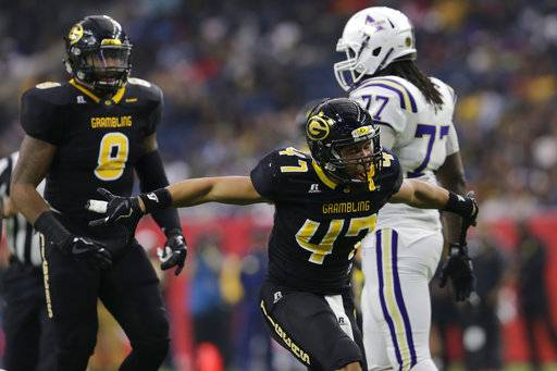 Grambling State linebacker De'Andre Hogues (47) celebrates after a sack in the first quarter against Alcorn State during the Southwestern Athletic Conference championship football game in Houston, Texas, Saturday, Dec. 2, 2017. (Tim Warner/Houston Chronicle via AP)