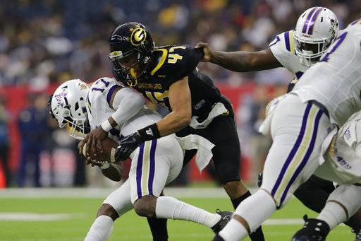 Alcorn State quarterback Lenorris Footman (17) is sacked by Grambling State linebacker De'Andre Hogues (47) during the first quarter of the Southwestern Athletic Conference championship football game Saturday, Dec. 2, 2017, in Houston. (Tim Warner/Houston Chronicle via AP)