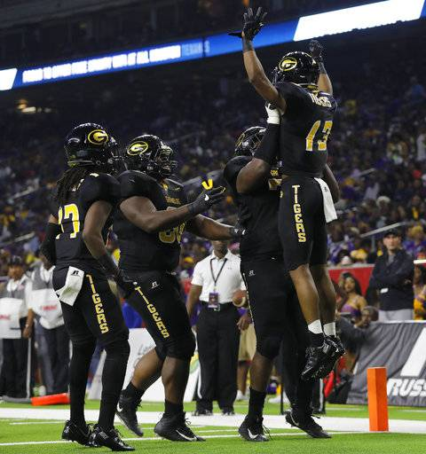 Grambling State wide receiver Quintin Guice (13) celebrates with teammates after a second-quarter touchdown against Alcorn State during the Southwestern Athletic Conference championship football game Saturday, Dec. 2, 2017, in Houston. (Tim Warner/Houston Chronicle via AP)