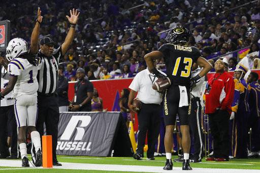 Grambling State wide receiver Quintin Guice (13) celebrates after a second-quarter touchdown against Alcorn State during the Southwestern Athletic Conference championship football game Saturday, Dec. 2, 2017, in Houston. (Tim Warner/Houston Chronicle via AP)
