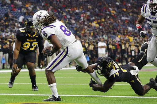 Alcorn State running back De'Lance Turner (8) rushes for a first-quarter touchdown as Grambling State defensive back T'Kevian Rockwell (14) defends during the Southwestern Athletic Conference championship football game Saturday, Dec. 2, 2017, in Houston. (Tim Warner/Houston Chronicle via AP)