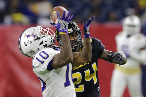 Alcorn State wide receiver Marquis Warford (10) catches a pass while defended by Grambling State defensive back Montrel Meander (24) in the fourth quarter during the Southwestern Athletic Conference championship football game in Houston, Texas, Saturday, Dec. 2, 2017. (Tim Warner/Houston Chronicle via AP)