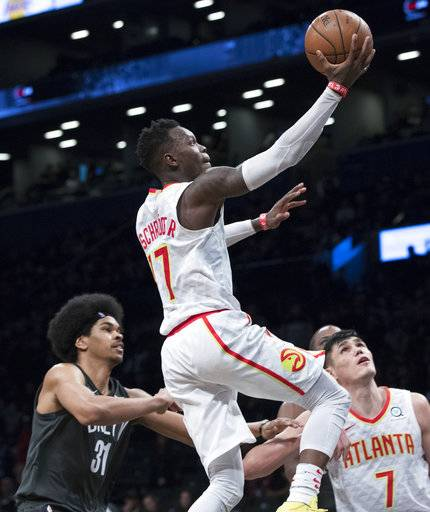 Atlanta Hawks guard Dennis Schroder (17) goes to the basket past Brooklyn Nets center Jarrett Allen (31) during the second half of an NBA basketball game, Saturday, Dec. 2, 2017, in New York. The Hawks won 114-102. (AP Photo/Mary Altaffer)