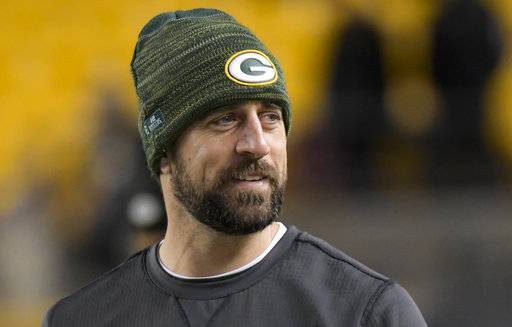 FILE - In this Sunday, Nov. 26, 2017, file photo, Green Bay Packers injured quarterback Aaron Rodgers watches warm ups before an NFL football game against the Pittsburgh Steelers in Pittsburgh. Rodgers is expected to return to practice on Saturday. The two-time MVP was placed on injured reserve six weeks ago after breaking his right collarbone in an Oct. 15 game against Minnesota. The (AP Photo/Don Wright, File)