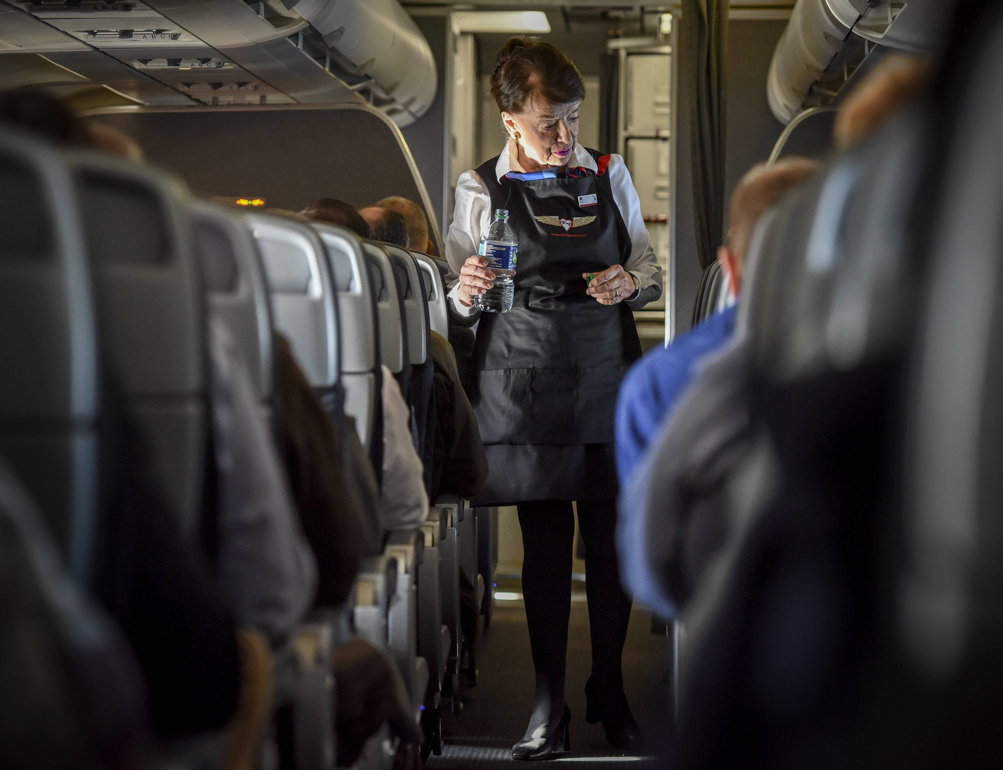 "Bette Nash, checking on her American Airlines passengers this month, still brings the people on her flight ""a little love and a little attention."""