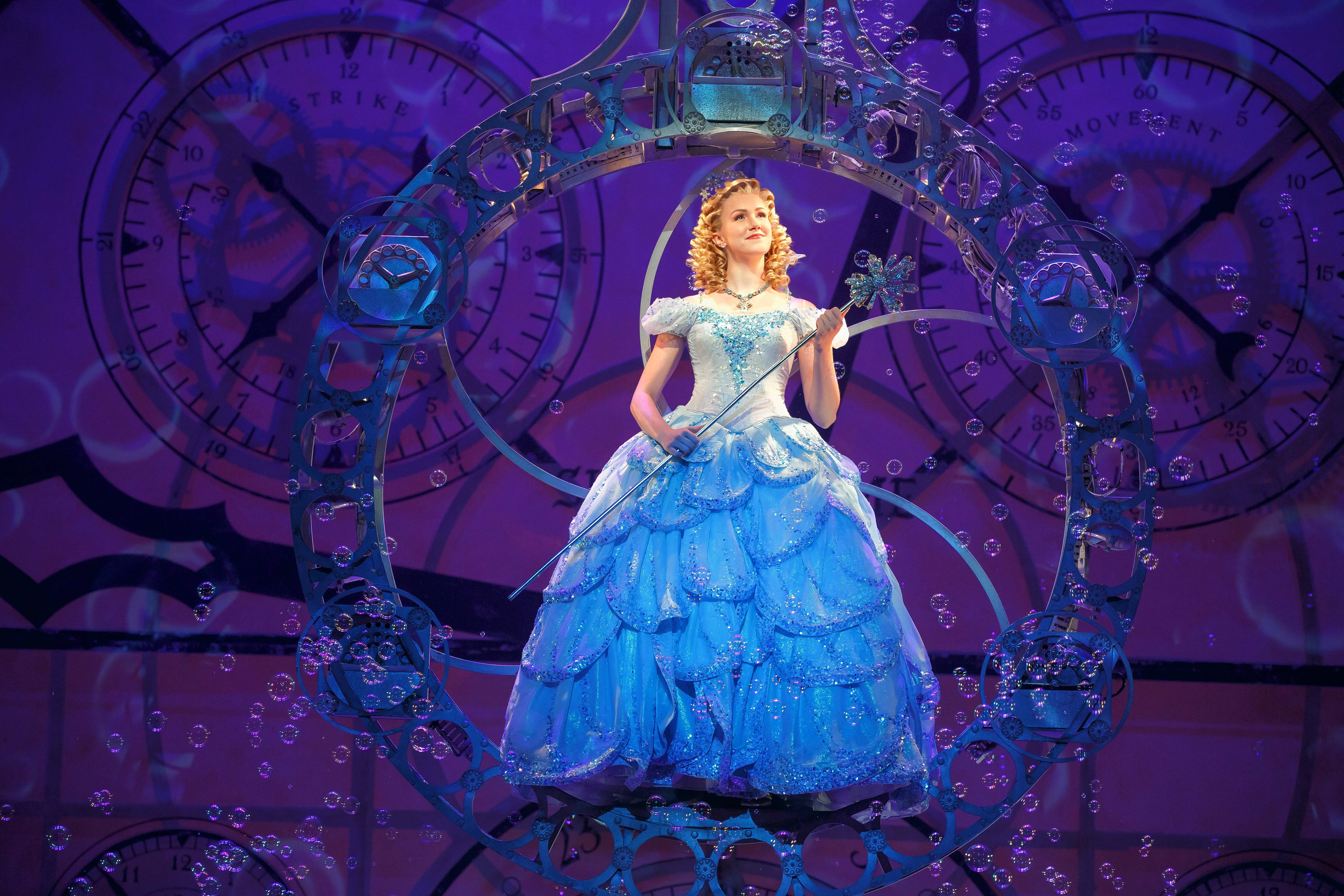 "The good witch Glinda (Ginna Claire Mason) arrives to inform the citizens of Oz about the death of Elphaba in ""Wicked."" The national tour of the 2003 Broadway blockbuster returns to Chicago Wednesday, Dec. 6."