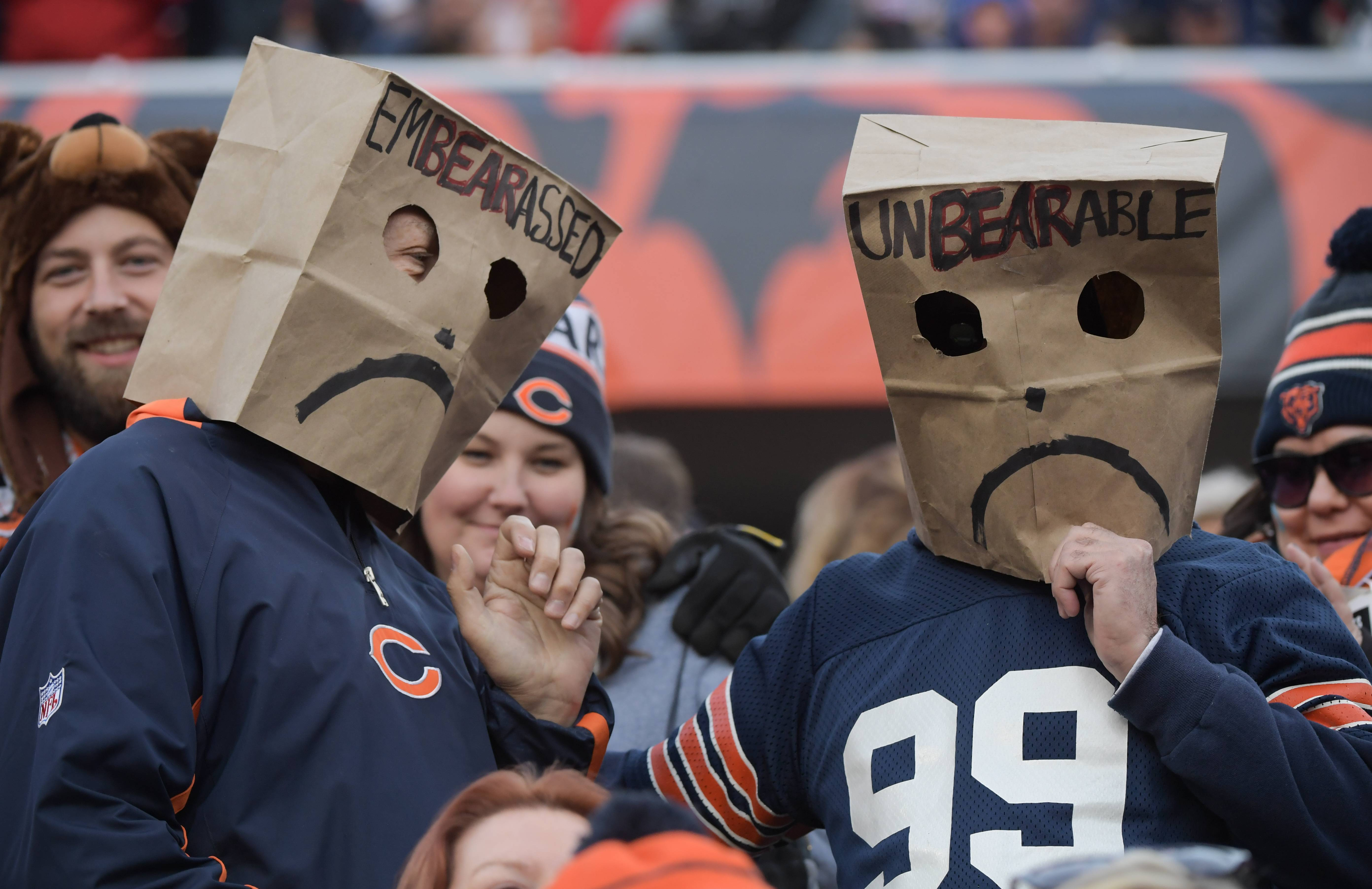 "A couple ""EmBEARassed"" and ""UnBEARable"" Chicago Bears fans cover their faces with paper bags during the Bears 14-15 loss to the San Francisco 49ers at Soldier Field on December 3, 2017."
