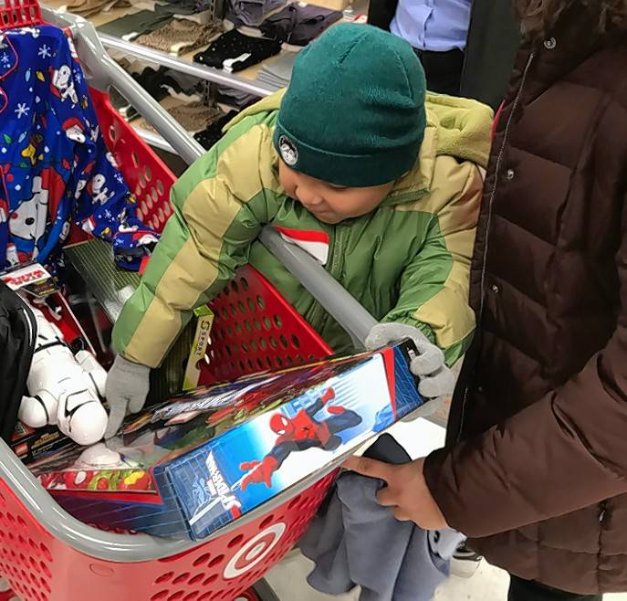 Jacniel Torres enjoys shopping with Community Service Officer Juan Acosta on Sunday during the Wauconda Police Department's first Shop with a Cop event.