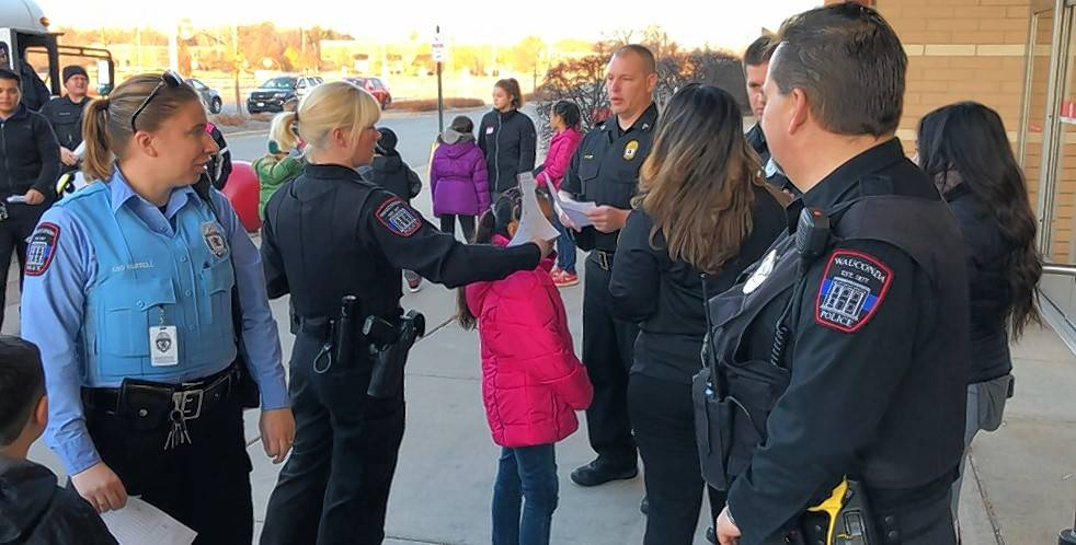 Wauconda police officers and area students gather in front of the Super Target in Mundelein Sunday for the department's inaugural Shop with a Cop event.