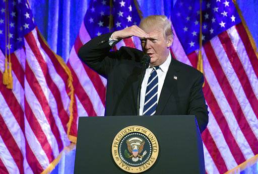 President Donald Trump looks for people in the audience as he speaks at a fundraiser at Cipriani in New York, Saturday, Dec. 2, 2017. Trump is attending a trio of fundraisers during his day in New York. (AP Photo/Susan Walsh)