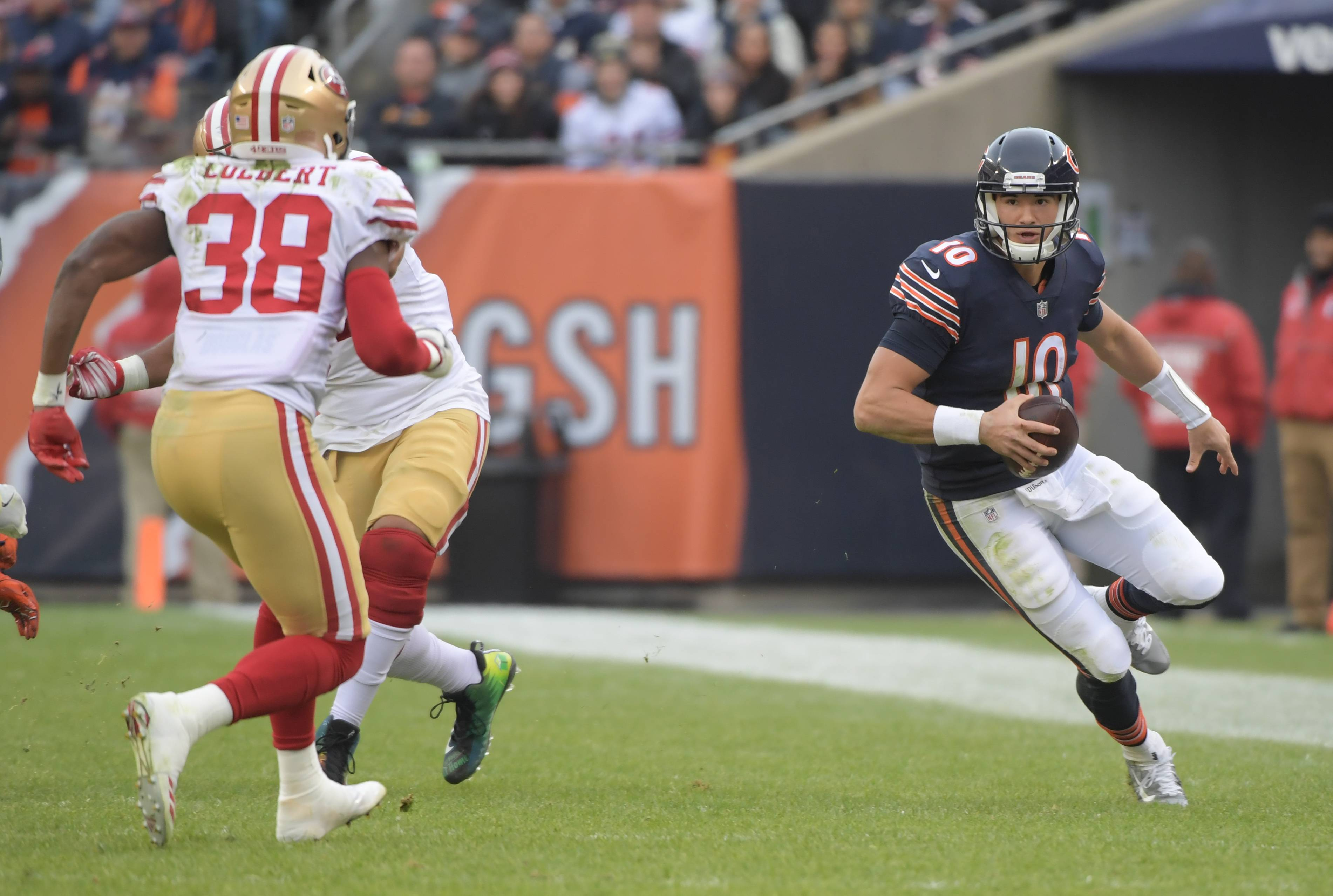 Chicago Bears' quarterback Mitchell Trubisky (10) scrambles with the ball toward the sideline during the Bears 14-15 loss to the San Francisco 49ers at Soldier Field on December 3, 2017.