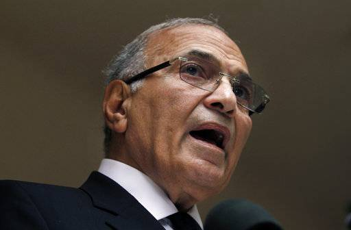 FILE - In this May 26, 2012 file photo, Egyptian presidential candidate Ahmed Shafiq speaks during a press conference at his office in Cairo, Egypt. There has been no word on the whereabouts of Shafiq, an Egyptian presidential hopeful who flew home from the United Arab Emirates almost 24 hours ago. Shafiq, a career air force officer who served as the last prime minister under ousted autocrat Hosni Mubarak, flew to Cairo from the Emirates on Saturday, ending nearly five years of exile in the Gulf Arab nation. (AP Photo/Khalil Hamra, File)