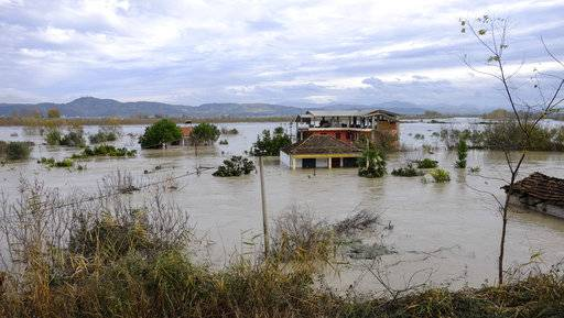 A view of a flooded area at Ferras village at Vlora district, 120 kilometers (75 miles) southwest of the capital Tirana, after non-stop rain caused Vjosa riverbanks to burst in the south of the country, Saturday, Dec. 2, 2017. At least one person has died in the last three days of heavy rainfall that has flooded many parts of Albania, temporarily paralyzing its ports and suspending flights from its only international airport. (AP Photo/Hektor Pustina)