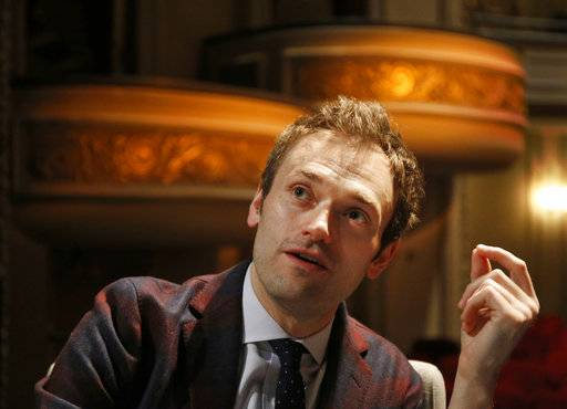 "FILE - In this April 5, 2016, file photo, Chris Thile speaks during an interview at the Fitzgerald Theater in St. Paul, Minn. Thile, who replaced Garrison Keillor as host of ""A Prairie Home Companion"" said the allegations against Keillor came as ""heartbreaking news."" Thile on Saturday, Dec. 2, 2017, addressed alleged improper conduct by Keillor in the opening minutes of the first show to be broadcast since news of the allegations broke. (AP Photo/Ann Heisenfelt, File)"