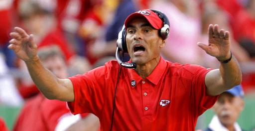 FILE - In this Nov. 2, 2008, file photo, Kansas City Chiefs coach Herm Edwards yells instructions to his team during an NFL football game against the Tampa Bay Buccaneers in Kansas City, Mo. Arizona State has hired former NFL coach and ESPN analyst Edwards as its football coach. The school announced the hiring Sunday night, Dec. 3, 2017, and will hold a news conference introducing Edwards on Monday morning. (AP Photo/Charlie Riedel, File)