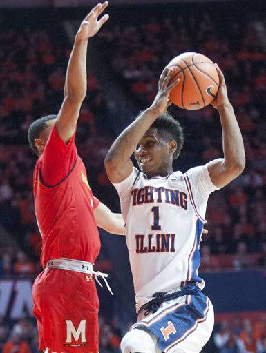 Illinois guard Trent Frazier, right, drives against Maryland guard Anthony Cowan during an NCAA college basketball game in Champaign, Ill., Sunday, Dec. 3, 2017. (AP Photo/Robin Scholz)