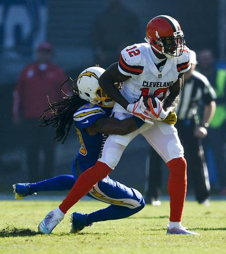 Cleveland Browns wide receiver Josh Gordon, right, is tackled by Los Angeles Chargers free safety Tre Boston during the first half of an NFL football game Sunday, Dec. 3, 2017, in Carson, Calif. (AP Photo/Kelvin Kuo)