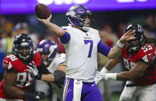 Minnesota Vikings quarterback Case Keenum (7) works under pressure from Atlanta Falcons defensive end Adrian Clayborn (99) during the second half of an NFL football game, Sunday, Dec. 3, 2017, in Atlanta. (AP Photo/John Bazemore)