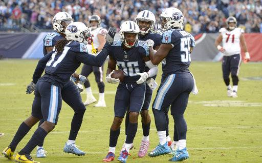 Tennessee Titans cornerback LeShaun Sims (36) celebrates after intercepting a pass in the end zone against Houston Texans in the fourth quarter of an NFL football game Sunday, Dec. 3, 2017, in Nashville, Tenn. The Titans won 24-13. (AP Photo/Mark Zaleski)