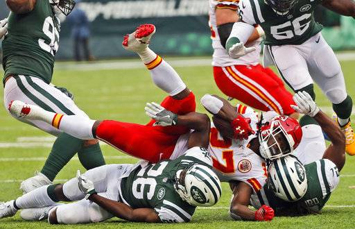 Kansas City Chiefs' Kareem Hunt (27), center, is brought down by New York Jets defenders during the second half of an NFL football game, Sunday, Dec. 3, 2017, in East Rutherford, N.J. (AP Photo/Julie Jacobson)