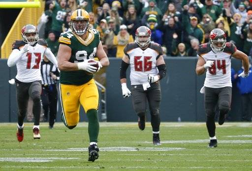 Green Bay Packers' Dean Lowry runs back a fumble recovery for a touchdown during the first half of an NFL football game against the Tampa Bay Buccaneers Sunday, Dec. 3, 2017, in Green Bay, Wis. (AP Photo/Mike Roemer)
