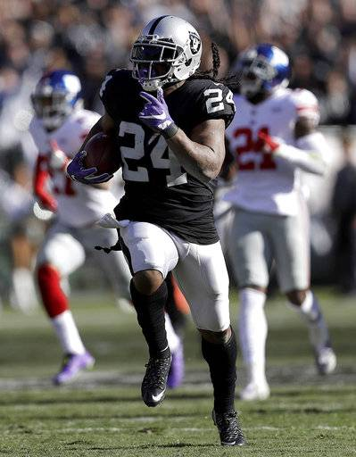 Oakland Raiders running back Marshawn Lynch (24) runs for a touchdown against the New York Giants during the first half of an NFL football game in Oakland, Calif., Sunday, Dec. 3, 2017. (AP Photo/Marcio Jose Sanchez)