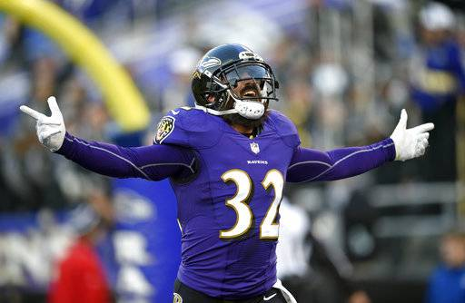 Baltimore Ravens free safety Eric Weddle celebrates after running an intercepted pass back for a touchdown in the second half of an NFL football game against the Detroit Lions, Sunday, Dec. 3, 2017, in Baltimore. (AP Photo/Nick Wass)