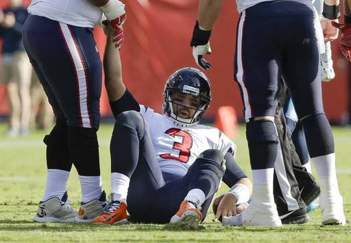 Houston Texans quarterback Tom Savage (3) is helped up after being sacked in the first half of an NFL football game against the Tennessee Titans Sunday, Dec. 3, 2017, in Nashville, Tenn.