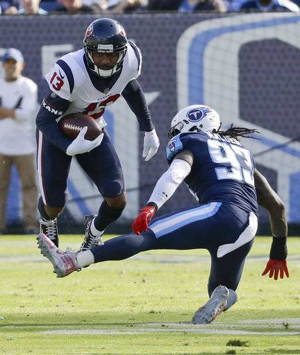 Houston Texans wide receiver Braxton Miller (13) leaps over the leg of Tennessee Titans linebacker Erik Walden (93) in the first half of an NFL football game Sunday, Dec. 3, 2017, in Nashville, Tenn.