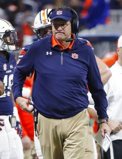 Auburn head coach Gus Malzahn walks the turf during the first half of the Southeastern Conference championship NCAA college football game against Georgia, Saturday, Dec. 2, 2017, in Atlanta. (AP Photo/David Goldman)