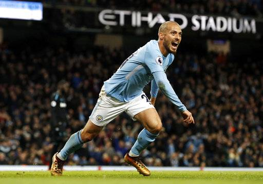 Manchester City's David Silva celebrates scoring his side's second goal during the English Premier League soccer match against West Ham United at the Etihad Stadium, Manchester, England, Sunday Dec. 3, 2017. (Martin Rickett/PA via AP)