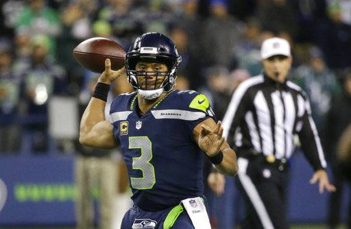 Seattle Seahawks quarterback Russell Wilson drops back to pass against the Philadelphia Eagles during the first half of an NFL football game, Sunday, Dec. 3, 2017, in Seattle. (AP Photo/Ted S. Warren)