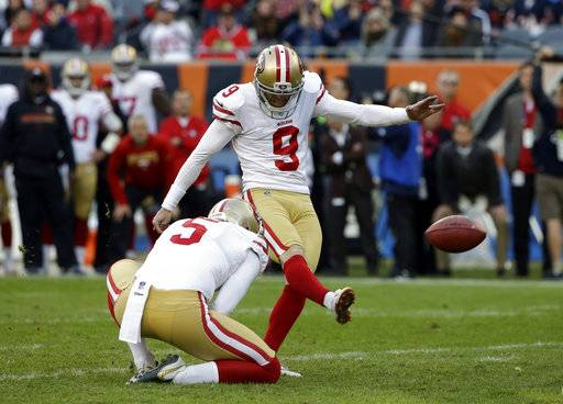 San Francisco 49ers kicker Robbie Gould (9) kicks a game winning field goal during the second half of an NFL football game against the Chicago Bears, Sunday, Dec. 3, 2017, in Chicago. The 49ers won 15-14.