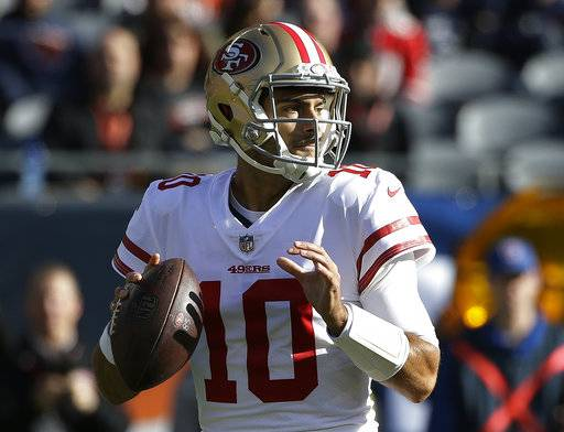 San Francisco 49ers quarterback Jimmy Garoppolo (10) looks for a receiver during the first half of an NFL football game against the Chicago Bears, Sunday, Dec. 3, 2017, in Chicago.
