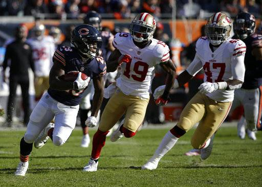 Chicago Bears running back Tarik Cohen (29) makes a 61-years touchdown run on a punt return during the first half of an NFL football game against the San Francisco 49ers, Sunday, Dec. 3, 2017, in Chicago.