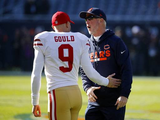 San Francisco 49ers kicker Robbie Gould (9) talks to Chicago Bears head coach John Fox before an NFL football game, Sunday, Dec. 3, 2017, in Chicago.
