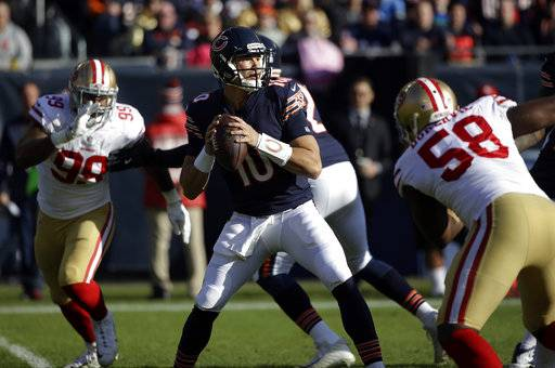 Chicago Bears quarterback Mitchell Trubisky (10) looks for a receiver during the first half of an NFL football game against the San Francisco 49ers, Sunday, Dec. 3, 2017, in Chicago.